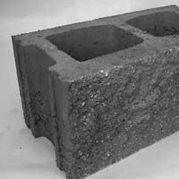 Блок стеновой песчано-бетонный рубленный серый.